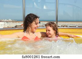 8f1183e6fe6b9 beautiful woman with her daughter both smiling in hot tub on cruise ship.