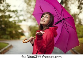 Free Art Print Of Happy Woman With Umbrella Checking For Rain In A