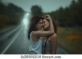 Lesbians kissing in the rain