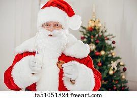 Free Art Print Of Santa Claus Drinking Milk And Eating Cookies