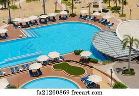 Free art print of Top view of Swimming pools at tropical beach in luxury  hotel